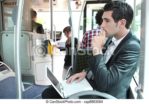 Commuter on a bus with a laptop - csp8863064