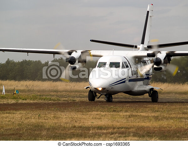 Commuter plane on taxiway - csp1693365