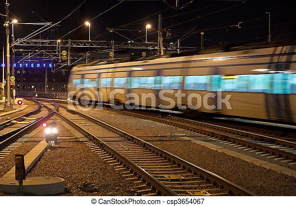 Commuter train with motion blur  - csp3654067