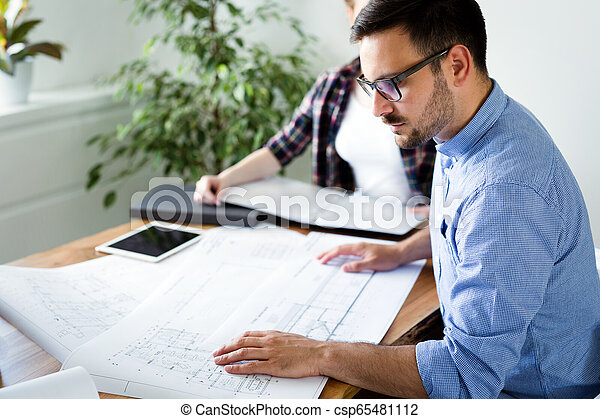 Company coworkers working in office - csp65481112