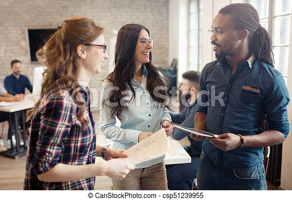 Company coworkers working in office - csp51239955