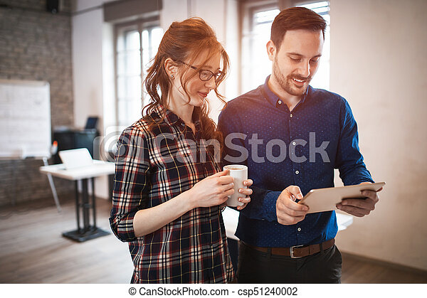 Company coworkers working in office - csp51240002