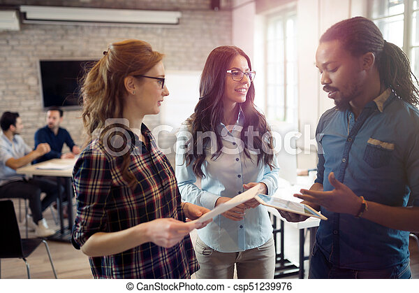 Company employees working in office - csp51239976