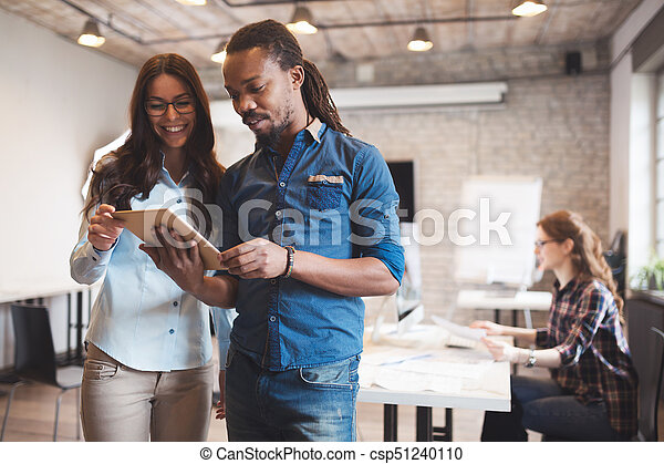 Company employees working in office - csp51240110