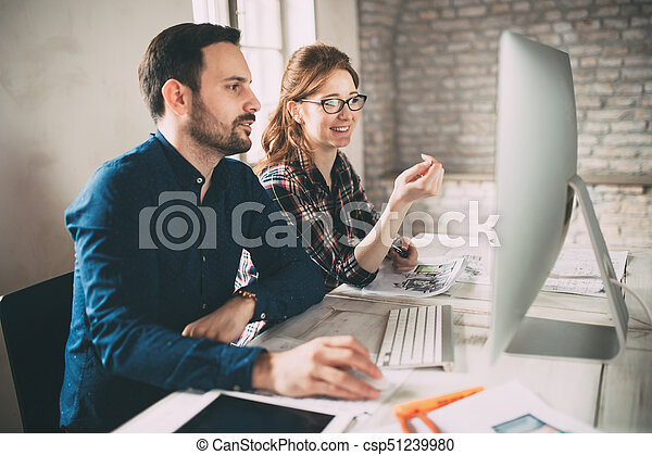 Company employees working in office - csp51239980
