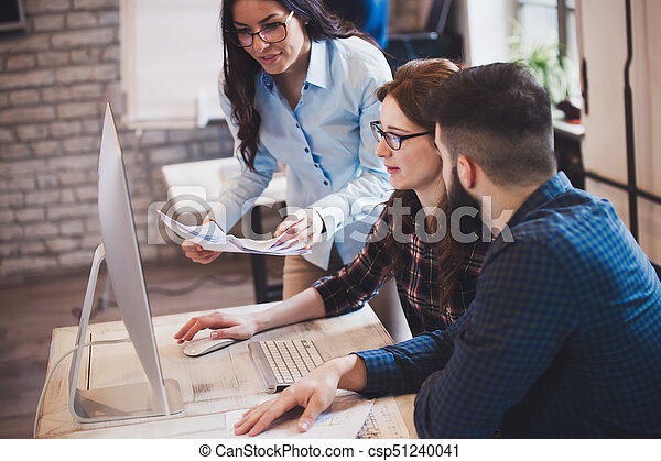 Company employees working in office - csp51240041