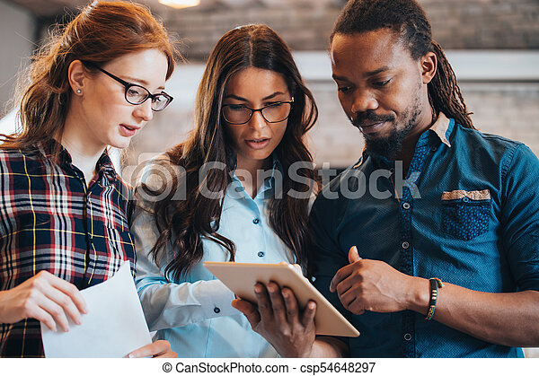 Company employees working in office - csp54648297