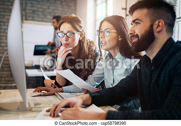 Company employees working in office - csp58798390