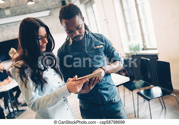 Company employees working in office - csp58798699