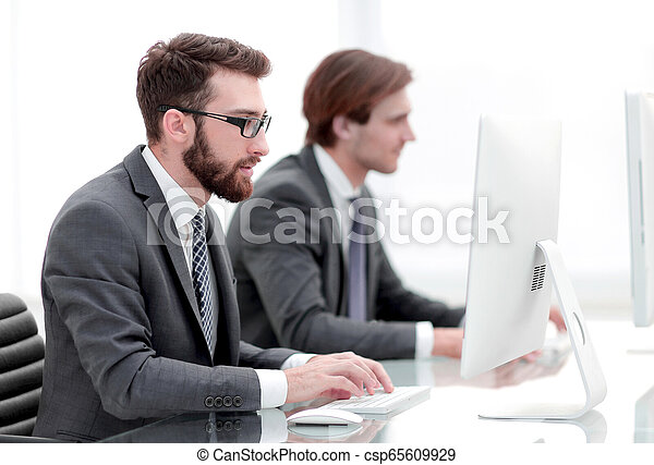 Company employees working in software development - csp65609929