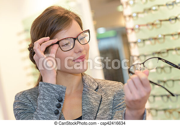 comparing two eyeglasses - csp42416634