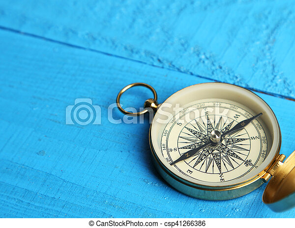 Compass on blue wooden background - csp41266386