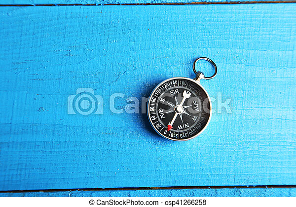 Compass on blue wooden background - csp41266258
