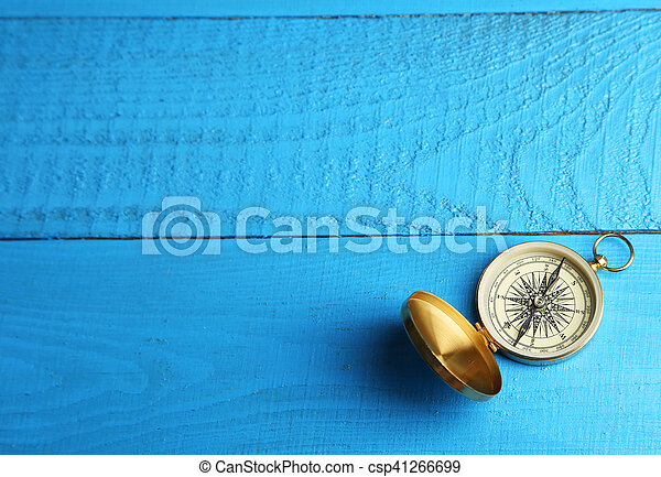 Compass on blue wooden background - csp41266699