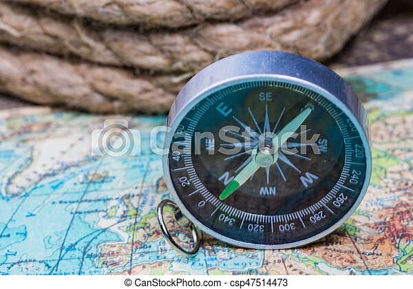 Compass on the world map compass lies on an ancient world map compass on the world map csp47514473 gumiabroncs Image collections