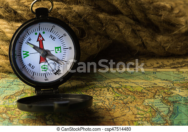 Compass on the world map compass lies on an ancient world compass on the world map csp47514480 gumiabroncs Image collections