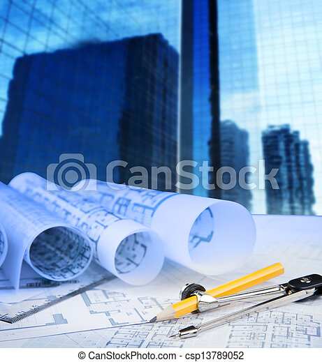 compass pencil blue print and office building in background - csp13789052
