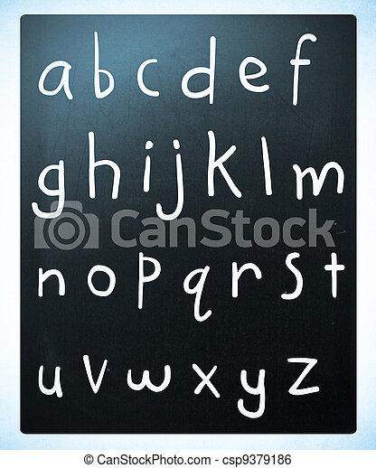 Complete english alphabet handwritten with white chalk on a blackboard - csp9379186
