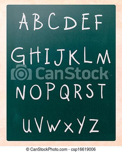 Complete english alphabet handwritten with white chalk on a blackboard - csp16619006