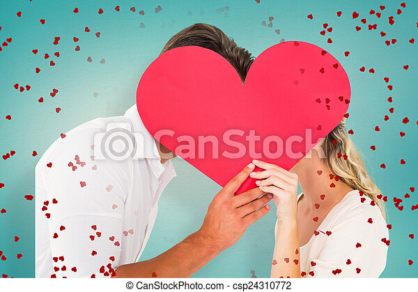 Composite image of attractive young couple kissing behind large  - csp24310772