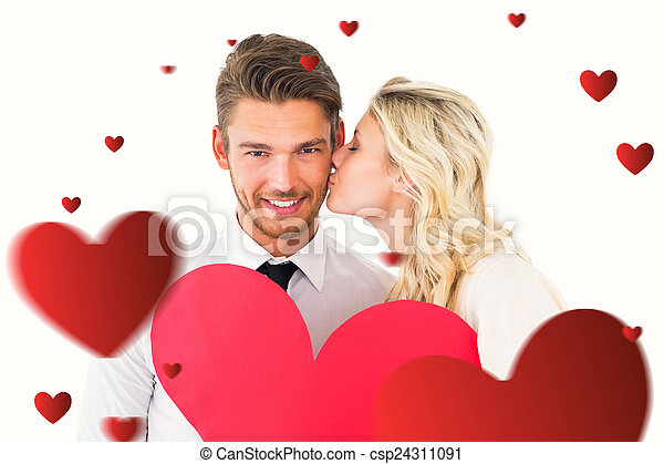 Composite image of attractive young couple holding red heart - csp24311091
