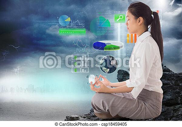 Composite image of businesswoman sitting in lotus pose - csp18459405