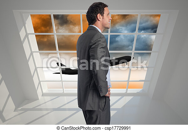 Composite image of smiling businessman with hand on hip - csp17729991