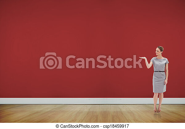 Composite image of woman in a dress holding her hand up - csp18459917