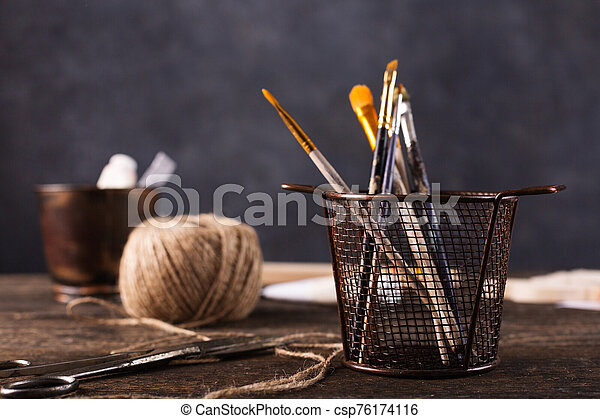Composition with different objects on the table. Making wooden christmas toys. - csp76174116