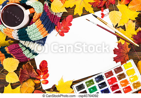 Composition with sheet of white paper, paints, brushes and autumn colorful leaves. - csp40764092