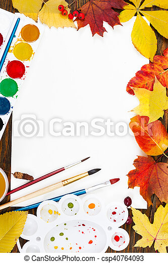 Composition with sheet of white paper, paints, brushes and autumn colorful leaves. - csp40764093