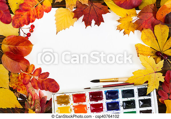 Composition with sheet of white paper, paints, brushes and autumn colorful leaves. - csp40764102