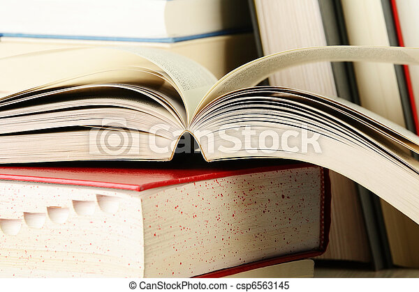 Composition with stack of books on the table - csp6563145