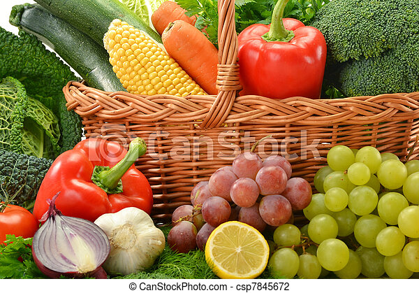 Composition with vegetables and fruits in wicker basket isolated on white - csp7845672