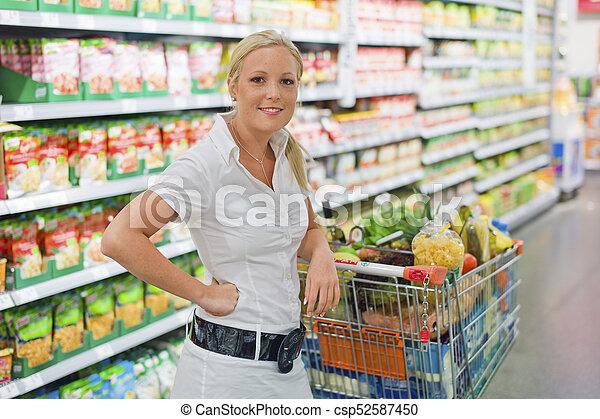 compras de mujer, supermercado, carrito - csp52587450