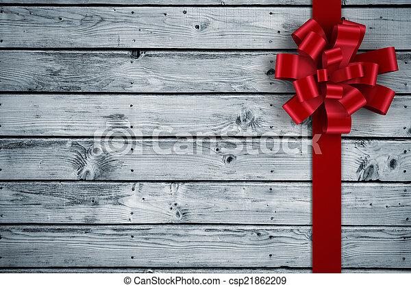 Imagen compuesta de lazo de Navidad y cinta roja - csp21862209