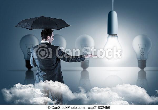 Una imagen compuesta de hombre de negocios sosteniendo un paraguas con la mano - csp21832456