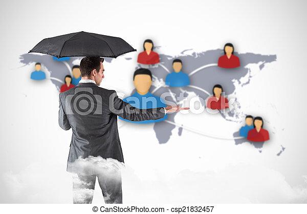 Una imagen compuesta de hombre de negocios sosteniendo un paraguas con la mano - csp21832457