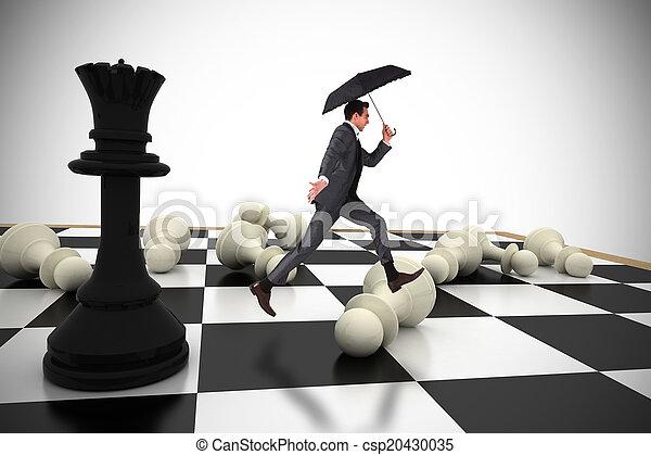 Una imagen compuesta de hombre de negocios saltando sosteniendo un paraguas - csp20430035