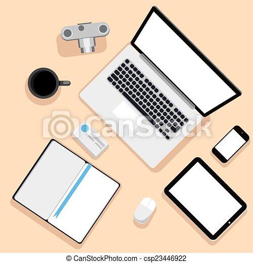 La mejor vista del lugar de trabajo con portátiles y dispositivos - csp23446922