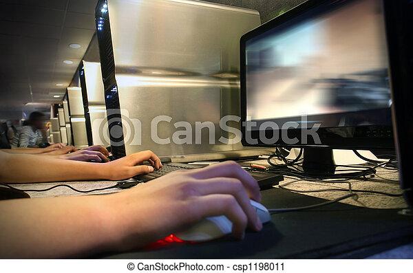 Computer Gaming at internet cafe - csp1198011