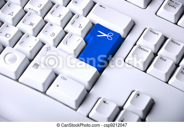 Computer Keyboard With Scissors Symbol On It
