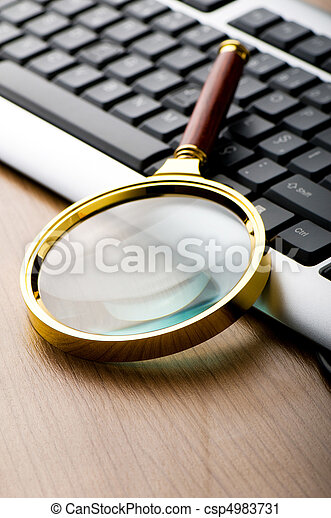 Computer security concept with keyboard and magnifying glass - csp4983731