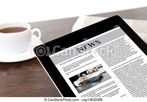 computer tablet with business news on screen on a table at a businessman in office - csp13632088