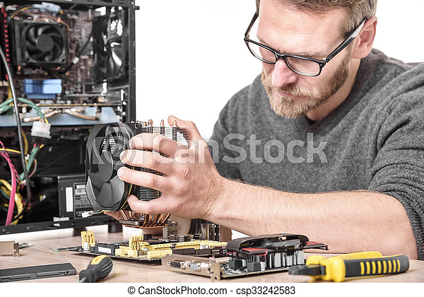 Computer technician installs cooling system. - csp33242583