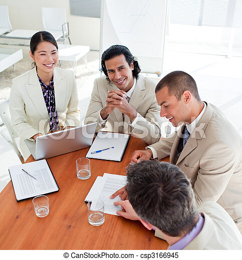 Concentrated business associates closing a deal in a meeting - csp3166945