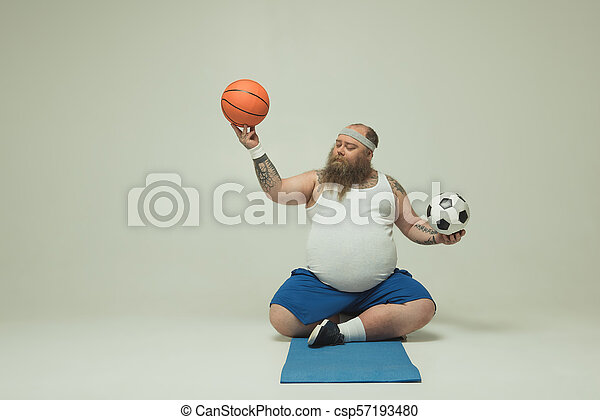 Chubby mature playing  with his balls