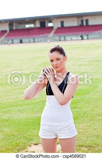 Concentrated female athlete holding - csp4569021