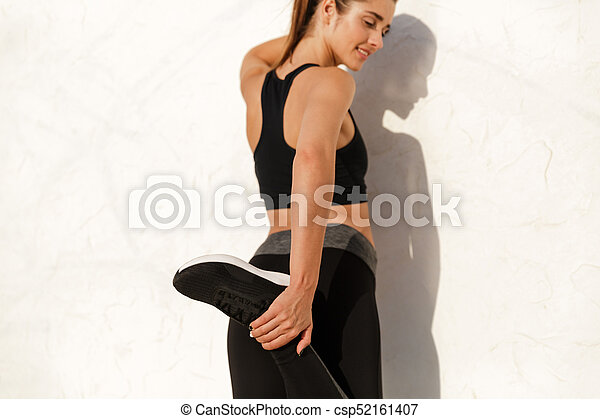 Concentrated lady making exercises while training - csp52161407