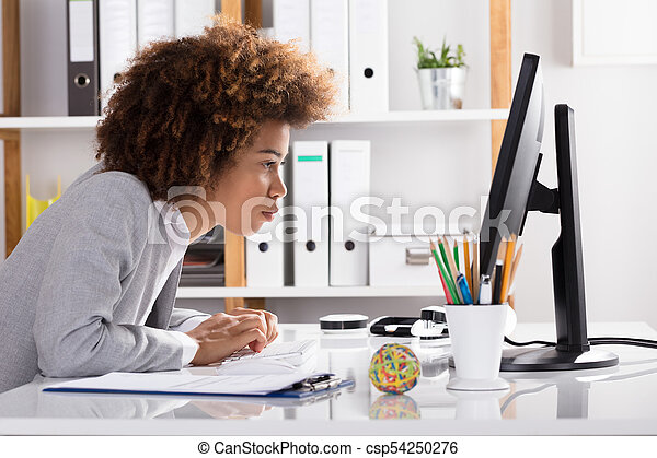 Concentrating Businesswoman Working On Computer - csp54250276